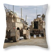 A Convoy Of Mrap Vehicles Near Camp Throw Pillow