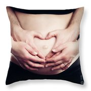 A Couple Touching Belly In A Heart Shape. Throw Pillow
