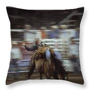 A Cowboy Rides A Bucking Bronco Throw Pillow