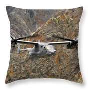A Cv-22 Osprey Flies Over The Canyons Throw Pillow