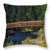 A Hiker Crosses A Bridge Throw Pillow