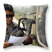 A Honduran Crew Chief Consults Throw Pillow