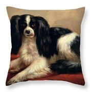 A King Charles Spaniel Seated On A Red Cushion Throw Pillow