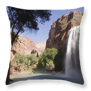 A Large Waterfall Hydrates A Narrow Throw Pillow