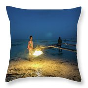 A Local Fisherman Uses Flame To Repair His Boat At Sunset Throw Pillow