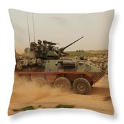 A Marine Corps Light Armored Vehicle Throw Pillow