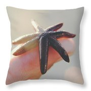 A Person Holds A Tiny Starfish Sea Star On Its Fingertip Of The Index Finger. Throw Pillow
