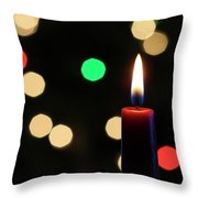 A Red Christmas Candle With Blurred Lights Throw Pillow