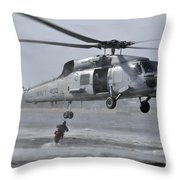 A Search And Rescue Swimmer Jumps Throw Pillow