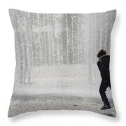 A Silhouette Of The Boy Against A Fountain Throw Pillow