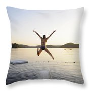 A Swimmer Jumps Off A Diving Board Throw Pillow