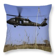 A U.s. Army Uh-60 Black Hawk Helicopter Throw Pillow by Stocktrek Images