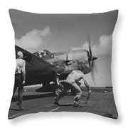 A Us Navy Fighter Pilot Gets The Take Off Flag From The Deck Crew Of An Aircraft Carrier Throw Pillow