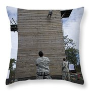 A U.s. Soldier Rappels Down A 40-foot Throw Pillow
