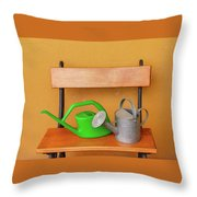 A Watering Can Of  Aluminium And A Plastic One Laid On Wooden Bench Throw Pillow