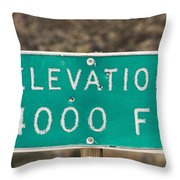 A Weathered Elevation Sign On Highway Throw Pillow