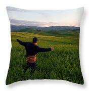 A Young Boy Runs Through A Field Throw Pillow