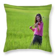 A Young Girl In A Folk Costume Plays A Vivaro In A Green Rice Fi Throw Pillow