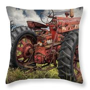 Abandoned Old Farmall Tractor In A Grassy Field Throw Pillow