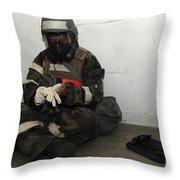 Airman Dons His Chemical Warfare Throw Pillow