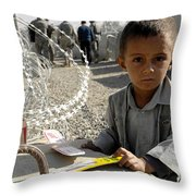an Afghan child Throw Pillow