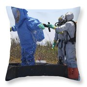 An Airman Stands In A Tub Of Cleaning Throw Pillow by Stocktrek Images
