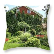 An Amana Garden Throw Pillow