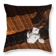An Astronaut Anchored To A Foot Throw Pillow