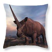 An Elasmotherium Grazing Throw Pillow