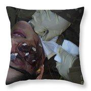 An Injured Patient Receives Medical Throw Pillow