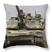 An M1a1 Abrams Tank Heading Throw Pillow