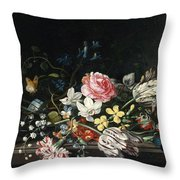 An Overturned Vase Of Flowers Resting On A Ledge Throw Pillow