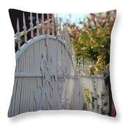 Angled Closeup Of White Washed Iron Gate To Garden Throw Pillow