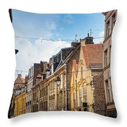 antique building view in Old Town Lille, France Throw Pillow