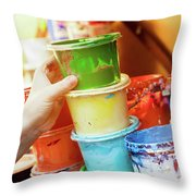 Artist Reaching For A Liquid Paint Container. Throw Pillow