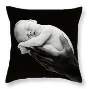 Tony Holding Georgia Throw Pillow by Anne Geddes