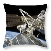 Astronauts Perform A Series Of Tasks Throw Pillow by Stocktrek Images