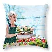 Attractive Gardener Selecting Flowers In A Gardening Center. Throw Pillow