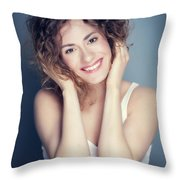 Attractive Young Woman Touching Her Hair And Face. Throw Pillow