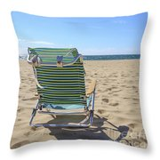 Beach Chair On A Sandy Beach Throw Pillow