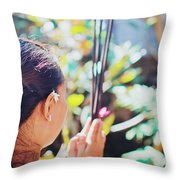 Beautiful Asian Woman Holding Incense Sticks During Hindu Ceremony In Bali, Indonesia Throw Pillow