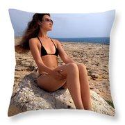 Beautiful Sexy Woman In Bikini Relaxing On A Rocky Seashore Throw Pillow