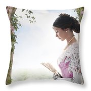 Beautiful Victorian Woman In Pink Dress Standing Under A Wisteri Throw Pillow