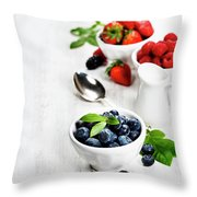 Berries In Bowls  On Wooden Background. Throw Pillow