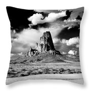 Between Monument Valley And Canyon De Chelley Throw Pillow