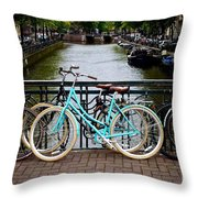 Bicycle Parked At The Bridge In Amsterdam. Netherlands. Europe Throw Pillow