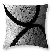 Bike Wheel Shadow Throw Pillow by Yali Shi
