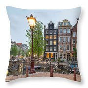 Bikes And Houses Along Canal At Dusk Throw Pillow