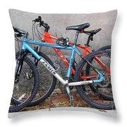 Bikes Left Alone Throw Pillow