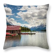 Boat House And Canoes On A Jetty At Maligne Lake In Canada Throw Pillow